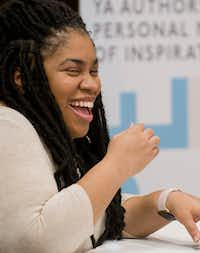 Author Angie Thomas laughs while participating in a panel discussion at the South Irving Library in Irving on Feb. 25, 2018.(Robert W. Hart/Special Contributor)