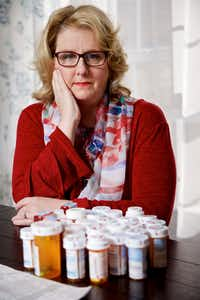 Patti Swearingen of Rowlett with over 30 prescriptions she has taken for a bladder infection she has had for more than five years. She is seeking an experimental treatment called phage therapy in Tbilisi, Georgia.(Brandon Wade/Special Contributor)