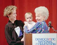 Texas state Treasurer Ann Richards, keynote speaker for the Democratic National Convention, takes her 16-month-old granddaughter, Lilly, from daughter Cecile Adams following a news conference July 15, 1988 in Atlanta.(1988 File Photo/The Associated Press)