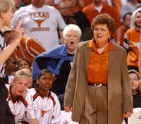 Texas Gov. Ann Richards and coach Jody Conradt dispute a call made by a referee during a Texas women's basketball game.(File Photo)