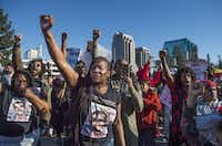 Veronica Curry raises her fist with other supporters of the Black Lives Matter movement during a rally on Interstate 5 in Sacramento, Calif., Thursday, March 22, 2018. (Hector Amezcua/The Sacramento Bee)