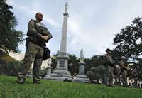 Texas state troopers guard the Confederate War Memorial before the March Against White Supremacy rally at Pioneer Park Cemetery in downtown Dallas, Saturday, August 19, 2017.(Tom Fox/Staff Photographer)
