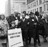 Civil rights leader Rev. Martin Luther King, Jr., (C) is accompanied by famed pediatrician Dr. Benjamin Spock (2nd-L), Father Frederick Reed (3rd-R) and union leader Cleveland Robinson (2nd-R) 16 March, 1967, during an anti-Vietnam War demonstration in New York. (-/AFP/GETTY IMAGES)