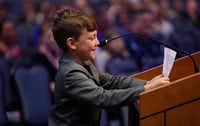 Nine-year-old Kain Hendrix is unable to hide a smile as he addresses school trustees as he spoke of the kindness and love and talent his art teacher, Stacy Bailey, shared with her students prior to her removal from the classroom last September. (Steve Hamm/Special Contributor)