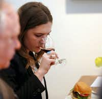 Sommelier Brooklyn Kannada sniffs a wine during a wine panel tasting paired with a grass-fed burgers.(Vernon Bryant/Staff Photographer)
