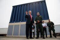 In this March 13, 2018 file photo, President Donald Trump talks with reporters as he reviews border wall prototypes in San Diego.(Evan Vucci/AP)