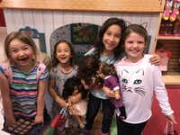 Libby Gonzales, second from right, celebrates her eighth birthday with friends at the American Girl Doll store.(Rachel Gonzales)