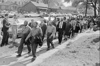 Martin Luther King Jr., front right, and Ralph  Abernathy lead a line of demonstrators who attempted to march on  city hall in Birmingham, Ala., in April, 1963. (HWC/AP)