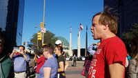 """Charles Hermes (right) of Grand Prairie screams """"No Trump!"""" as part of a chant delivered by demonstrators gathered across from Belo Mansion in downtown Dallas in October. More than 100 demonstrators rallied to protest the president's Dallas visit for a private fundraiser.(Marc Ramirez/Staff)"""