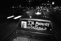 Ben Cantu (left) and his girlfriend,  Christina Espinosa, cruise down Oak Lawn  after a prayer  gathering for Selena at Reverchon Park on April 2, 1995.(Irwin Thompson/Staff Photographer)