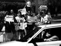 April 7, 1995: About 50 to 60 protesters gather outside KEGL radio in  Las Colinas on April 7, 1995, to protest Howard Stern's show.(Juan Garcia/The Dallas Morning News)