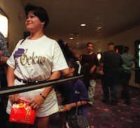 Elsa Salazar of Euless waits in line March 21, 1997, to  enter the 7 p.m. showing of <i>Selena</i> at the AMC Grand.(Randy Eli Grothe/The Dallas Morning News)
