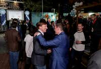 Andrew White (front left) a Democratic candidate for governor, greets Beau Miller during an election watch party at Raven Tower in Houston on Tuesday, March 6, 2018. (Jon Shapley/Houston Chronicle)