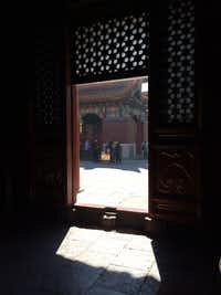 A threshold at the Yonghe Temple in Beijing provides a play of shadow and light.(Thomas Huang/The Dallas Morning News)