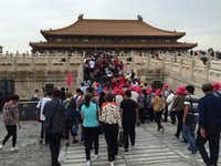 Long lines of tourists stream into one of the buildings at the Forbidden City in Beijing, China, in September 2017. (Thomas Huang/The Dallas Morning News)