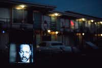 The Rev. Martin Luther King Jr. is visible on a video screen installed in the parking lot of the former Lorraine Motel in Memphis on March 21, 2018.  King, 39, was shot to death on the balcony outside his room at the motel by an escaped convict, James Earl Ray, on April 4, 1968. The former motel is now part of the National Civil Rights Museum.(Andrea Morales/The New York Times)