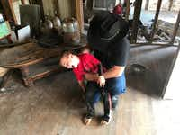 Chris Ward tickles his son, 6-year-old Ryland Ward, at the family home he and his brother are remodeling in La Vernia, Texas, on April 2, 2018. Ward lost his wife and two daughters in the shooting at the First Baptist Church of Sutherland Springs. Ryland, who was shot four times in the massacre, has undergone several surgeries and hours of physical therapy. (Lauren McGaughy/Staff)(Lauren McGaughy/Staff)
