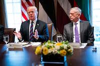Defense Secretary Jim Mattis looks on as President Donald Trump speaks during a working lunch with Baltic leaders, at the White House on April 3, 2018. Trump, who has been stewing publicly for days about what he characterizes as lax immigration laws, said here that he plans to order the military to guard the border with Mexico.(DOUG MILLS/NYT)