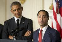President Barack Obama, left, listens to San Antonio Mayor Julian Castro after announcing the nomination of Castro to lead the Department of Housing and Urban Development in 2014. (Pablo Martinez Monsivais/AP)