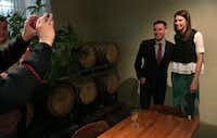 <p>Ohio State Rep. Kathleen Clyde, right, Democratic secretary of state candidate in Ohio, poses for photos with Jason Kander, founder of the national voter advocacy group Let America Vote, during a fundraiser in Columbus, Ohio, on Jan. 25.&nbsp;</p>(Julie Carr Smyth/AP)