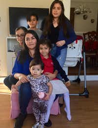 Lucia Mejia and her children await the outcome of Adolfo Mejia's deportation case. The children are U.S. citizens, and the mother is a legal resident. (Dianne Solis/Staff)