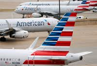 American Airlines planes in between terminals A and C at DFW International Airport.(Vernon Bryant/Staff Photographer)