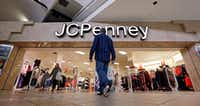 A shopper heads into a J.C. Penney store in Seattle The Plano-based company recorded a tax benefit after the tax law was passed.(Elaine Thompson/AP)