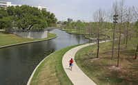 Farmers Branch creek flows though Vitruvian Park in Addison, Texas. The creek is a point of dispute between the neighboring cities of Farmers Branch and Addison. (Louis DeLuca/Staff Photographer)