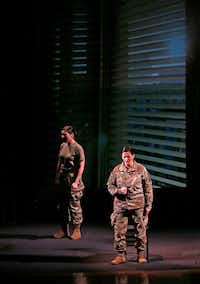 Staff Sgt. Michaela Shelton, portraying The Soldier, left, and Master Sergeant Rose Ryon, portraying Toledo, perform during a dress rehearsal of <i>The Rising and the Falling</i>.(Jae S. Lee/Staff Photographer)