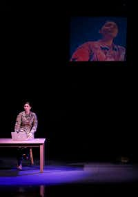 Staff Sgt. Michaela Shelton, portraying The Soldier, performs onstage during a dress rehearsal of <i>The Rising and the Falling </i>on Thursday, April 5, 2018. (Jae S. Lee/Staff Photographer)