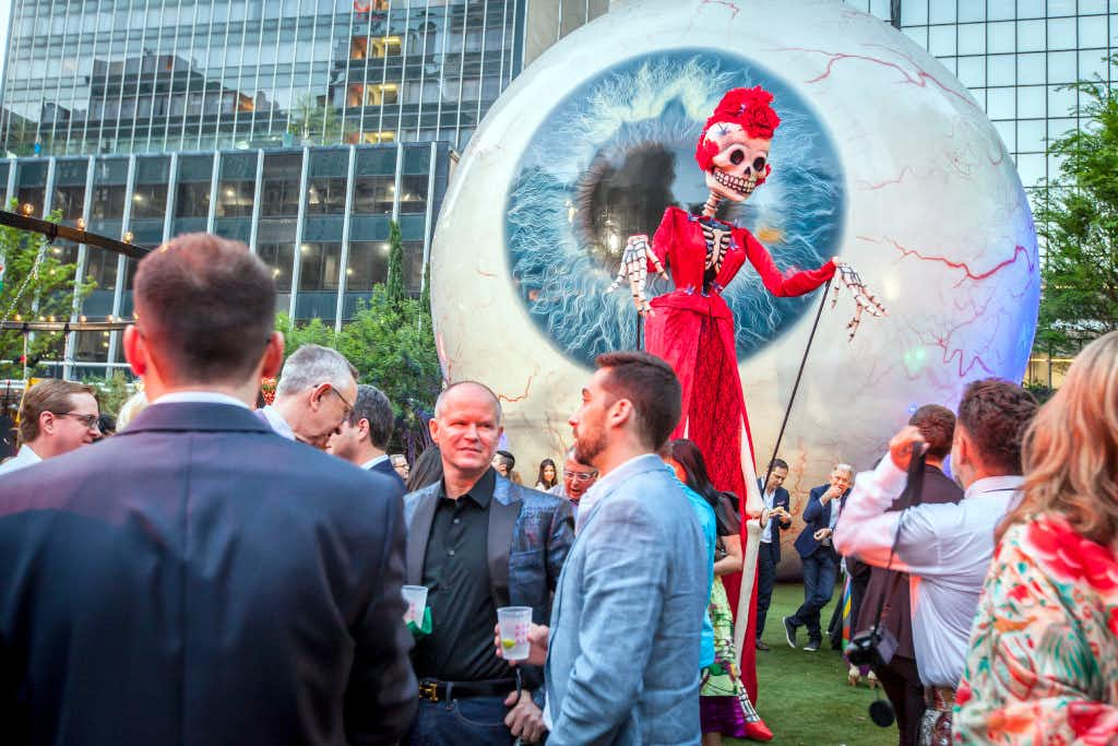 A tall skeleton like figure walks among the party goers at the Eye Ball Party downtown celebrating the Dallas Art Fair in 2017. (Ron Heflin/Special Contributor)(Ron Heflin/Special Contributor)