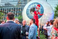 A tall skeletonlike figure walks among the partygoers at the Eye Ball Party downtown celebrating the Dallas Art Fair in 2017. (Ron Heflin/Special Contributor)