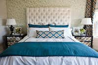 When going with bold patterns in other areas of the room, simple, classic options on the bed keep things from getting too crazy, says Abbe Fenimore.(Melanie Johnson)