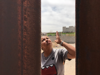 "<p><span style=""font-size: 1em; background-color: transparent;"">Maria Lourdes Campos points to the top of the fence near her home and says she's in favor of calling it a wall so President Trump can leave border residents alone&nbsp;</span><br></p><p></p>(Alfredo Corchado/The Dallas Morning News)"