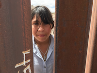 Michelle Aide Campos, 12, isn't happy with barriers that went up almost a year ago near her home in Anapra, Mexico. But, she added, the steel, rustic bollard fence is better than a concrete wall. (Alfredo Corchado/The Dallas Morning News)