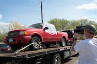 A vehicle is towed from the front of the home of Mark Anthony Conditt on March 22, 2018 in Pflugerville. Conditt, the 23-year-old suspect in the Austin package bombings, blew himself up inside his SUV as police tried to take him into custody.(Scott Olson/Getty Images)