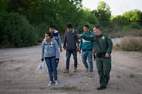A Border Patrol agent apprehends immigrants shortly after they crossed the border from Mexico into the United States on Monday, March 26, 2018 in the Rio Grande Valley Sector near McAllen, Texas. An estimated 11 million undocumented immigrants live in the United States, many of them Mexicans or from other Latin American countries. / AFP PHOTO / LOREN ELLIOTT/AFP/Getty Images(LOREN ELLIOTT/AFP/Getty Images)