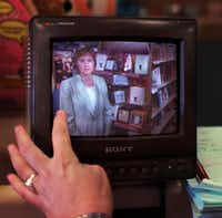 Peggy Wehmeyer is pictured on a monitor while her producer critiques a segment for <i>Good Morning America</i> about the book <i>The Prayer of Jabez</i>&nbsp; in May 2001 at a Garland bookstore.(2001 File Photo/Staff)