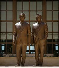 Sculptor Chas Fagan of Charlotte created the 8-foot bronze statues of former Presidents George W. Bush, left, and George H.W. Bush in the courtyard of the George W. Bush Presidential Center.(Tom Fox/Staff Photographer)