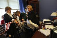 Sen. Kirsten Gillibrand of New York on Capitol Hill on Jan. 27, 2009, with her son, Theo, 5, and mother, Polly Noonan Rutnik.(File Photo/The New York Times)