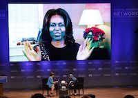 Former First Lady Laura Bush, left, joined First Lady Michelle Obama via teleconference as Onaba Payab, of Afghanistan, right, moderator, at the Bush Center in Dallas for an interactive conversation about the First Ladies work to improve the lives of women and girls.(David Woo/Staff Photographer)