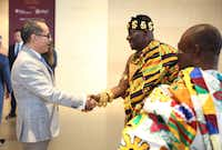 Agustin Arteaga, director of the Dallas Museum of Art, shakes the hand of  Daasebre Osei Bonsu II, Mamponghene, the second-in-command in the Asante traditional hierarchy, who is standing with Emmanuel Kofi Pepra-Omani, Stool Elder, a member of the Asante royal delegation from Ghana.(Dallas Museum of Art)
