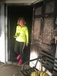 Grace Grapevine Executive Director Shonda Schaefer surveys fire damage at the nonprofit's medical clinic in Grapevine.(Facebook/Grace Grapevine)