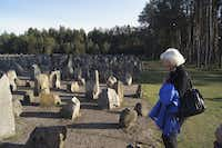 Magda Bader pays respects to a memorial tribute for murdered Jews at Treblinka, a Nazi concentration camp in Poland. (Naomi Martin/ Staff)