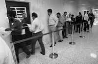 Last-minute tax filers line up at  the IRS window in the lobby of the federal building in downtown Dallas  to obtain the necessary tax-return forms. (Eric Schlegel/The Dallas Morning News)