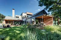 """Known as """"River House II,"""" the Bluffview residence of Brenda and Bill Bogert is built on a sloping lot overlooking 50 acres of the Bachman Branch creek greenbelt.(Charles Davis Smith)"""