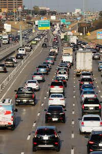 Vehicles traveling east and west on Interstate 635 near  Skillman Street, one of many areas where LBJ Freeway has no continuous frontage roads. A single HOV/tolled express lane in each direction backs up daily with the other traffic through Lake Highlands. (David Woo/The Dallas Morning News)(David Woo/Staff Photographer)