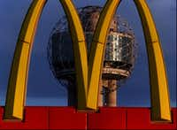 Two icons converge: the Reunion Tower ball and a set of McDonald's golden arches, in 1996.(David Leeson/The Dallas Morning News)