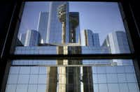 Reunion Tower is reflected in window panes of the Hyatt Regency hotel in downtown Dallas in 2009. The landmark tower had been closed to the public for more than a year for renovations, including the opening of a new restaurant by celebrity chef Wolfgang Puck.(G.J. McCarthy/The Dallas Morning News)