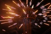 Fireworks fly from Reunion Tower during the New Year's Eve event in Dallas on December 31, 2016. (Nathan Hunsinger/Staff Photographer)